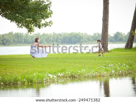 Romantic Young Indian-Caucasian Mixed Race Family with Young Son in White and Khaki Outdoors in Autumn - stock photo