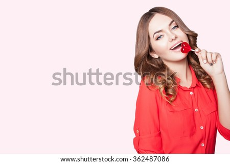 Romantic young woman.Love and feelings red heart in the hands.Valentine's day young woman with a big smile in her hands red heart on a light background - stock photo