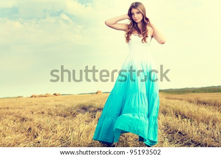 Romantic young woman posing outdoor. - stock photo