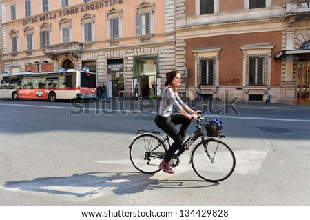 ROME - APR 28:Italian woman rides bicycle on April 28 2011 Rome,Italy.From May till September the historic center of Rome is closed to automobile every second Sunday to reduced air and noise pollution