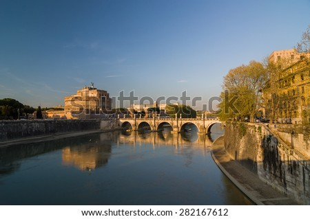 ROME - APRIL 17, 2013: Beautiful sunset in Rome. The Mausoleum of Hadrian (Castle of the Holy Angel, Castel Sant'Angelo). Ponte Sant'Angelo (Aelian Bridge) across the Tiber river. Rome, Italy. - stock photo