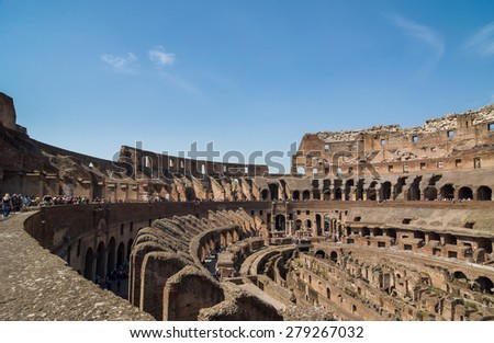 ROME - APRIL 17, 2013: Interior of The Colosseum (Coliseum) also known as the Flavian Amphitheatre on a sunny spring day. Arena and hypogeum. One of the main attractions of the city. Rome, Italy. - stock photo