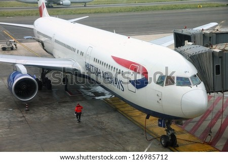 ROME - APRIL 11: Passengers board British Airways Boeing 767 at Fiumicino Airport on April 11, 2012 in Rome, Italy. With 116.8 millions passenger-kilometer flown, BA is the 9th largest airline worldwide. - stock photo