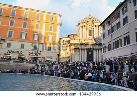 ROME - APRIL 28: Visitors at Trevi Fountain on April 28 2011 in Rome, Italy.It is the largest Baroque fountain in the city and one of the most famous fountains in the world. - stock photo