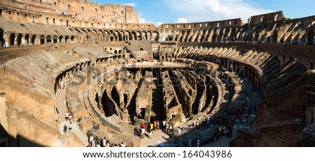 ROME-AUGUST 25: The Colosseum on August 25,2013 in Rome, Italy. The Colosseum is an elliptical amphitheatre in the centre of the city of Rome, Italy. - stock photo