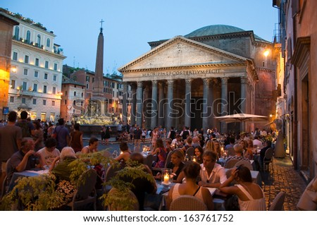 ROME-AUGUST 8: The Pantheon at night on August 8, 2013 in Rome, Italy. The Pantheon is a building in Rome, Italy to all the gods of ancient Rome rebuilt by the emperor Hadrian about 126 AD. - stock photo