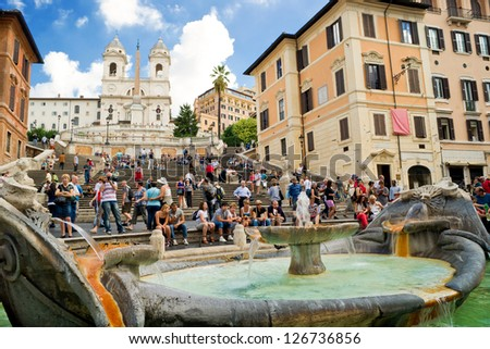 ROME - CIRCA OCTOBER 2012: The Spanish Steps, seen from Piazza di Spagna with Fountain Fontana della Barcaccia circa october 2012, Rome.The Spanish Steps are the widest staircase in Europe. - stock photo