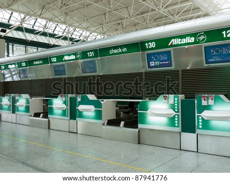 ROME - CIRCA SEPTEMBER 2011: Alitalia check-in desks at Fiumicino airport, circa September 2011, Rome. In 2010 Alitalia, Italy's biggest and the world's 19th airline had 23,4 million passengers. - stock photo