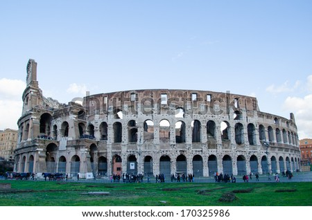 ROME-DEC 1, 2012: Visitors around the Coliseum on Dec 1, 2012 in Rome. The Colosseum is one of the landmarks of Rome and receives thousands of visitors everyday.