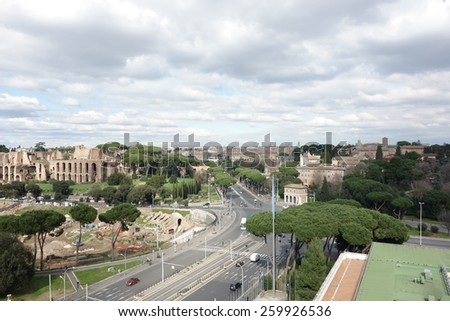 ROME - FEBRUARY 23, 2015:  Aerial view of the via di San Gregorio in Rome with a sight of the Circus maximus, Palatine hill and the Colosseum - stock photo