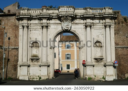ROME - FEBRUARY 23, 2015:  people at the old gate walls date back to 1644, this  is the famous place that gives the market its name, Porta Portese - stock photo