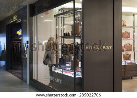 Rome, Italy - April 25, 2015: Burberry store at Fiumicino Airport in Rome, Italy. Burberry is a British luxury fashion house founded in 1856 by 21 year old Thomas Burberry. - stock photo
