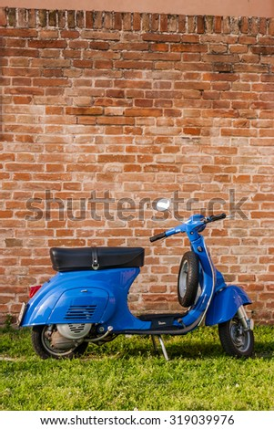 ROME, ITALY - APRIL 10 2010: Old Blue Vespa parked on green lawn in Rome, Italy. - stock photo