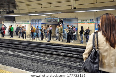 ROME,ITALY - APRIL 19: Passengers wait for subway train on April 19, 2011 in Rome,Italy. Rome Metro has annual ridership of 331 million on its 2 lines. 3rd line is under construction. - stock photo