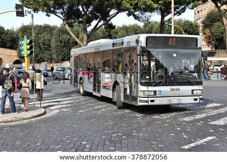 ROME, ITALY - APRIL 9, 2012: People ride Iveco bus operated by ATAC in Rome. With 350 bus lines and 8000 bus stops, ATAC is one of the largest bus operators in the world. - stock photo