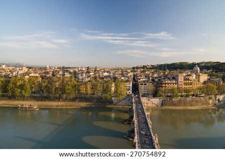 ROME, ITALY - APRIL 16, 2013: Ponte Sant'Angelo (Aelian Bridge) across the Tiber river. Aerial view from the Mausoleum of Hadrian, known as Castle of the Holy Angel (Castel Sant'Angelo). Rome, Italy. - stock photo