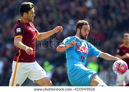 ROME, ITALY - April 2016 :Zukanovic Higuain  in action during fotball match  serie A  League 2015/2016 between A.s. Roma  vs Napoli  at the Olimpic Stadium  on april 25, 2016 in Rome. - stock photo