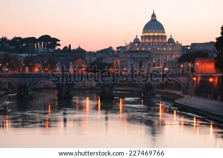 ROME, ITALY -AUGUST 22, 2014: Monumental St. Peters Basilica over Tiber at night in Rome, Italy. St. Peters Basilica is papal late renaissance basilica consecrated in 1626.