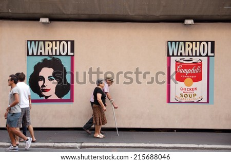 ROME, ITALY - AUGUST16, 2014:  people in front of Palazzo Cipolla. on display in the halls of the Museum, the most important groups of works by the Father of American Pop Art Andy Warhol  - stock photo