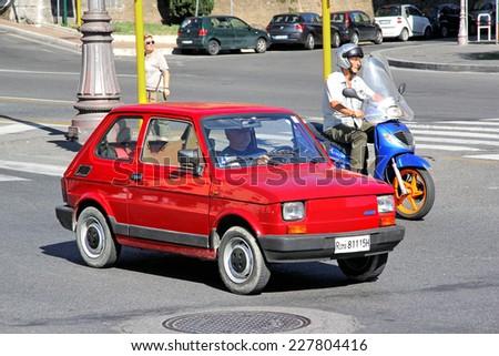 ROME, ITALY - AUGUST 1, 2014: Red tiny retro car Fiat 126 at the city street. - stock photo