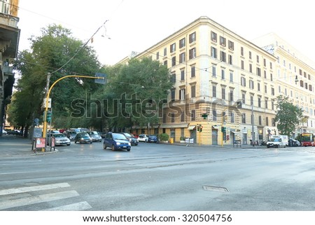 Rome, Italy - August 17, 2015: Traffic at the intersection of streets in Rome early in the morning