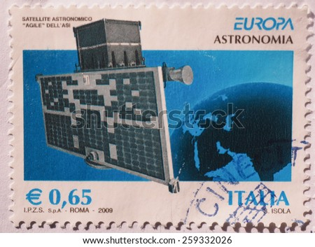 ROME, ITALY- CIRCA DECEMBER 2014: 65 eurocent stamp from Italy showing the Italian astronomic satellite named Agile - stock photo