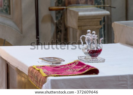 ROME, ITALY - CIRCA JANUARY 2016 -  Ampules, glass cruets with wine and water for the Holy Mass in Catholic church of St Nicholas in Rome - stock photo