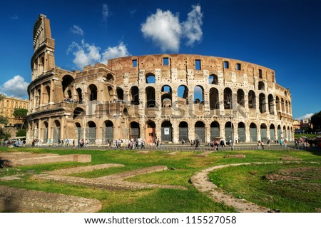 Rome, Italy. Coliseum in the sunlight. Rome landmark. It is one the main travel attractions of Rome. Ruins in central Rome.
