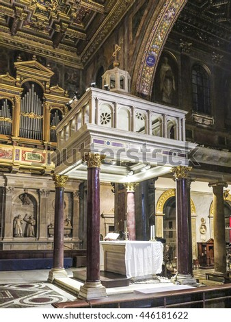 ROME, ITALY, DEC 23, 2015 : Altar space of the ancient basilica of Santa Maria in Trastevere, with ancient gilded mosaics. - stock photo
