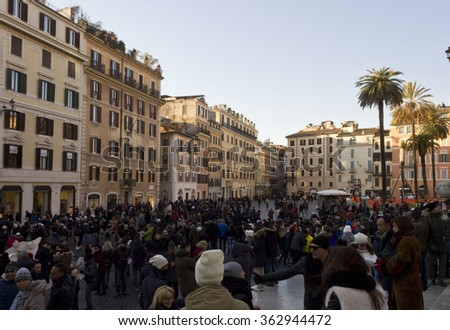 ROME, ITALY - DECEMBER 31 2014: Crowd of People in Piazza di Spagna square in Rome, at day time - stock photo