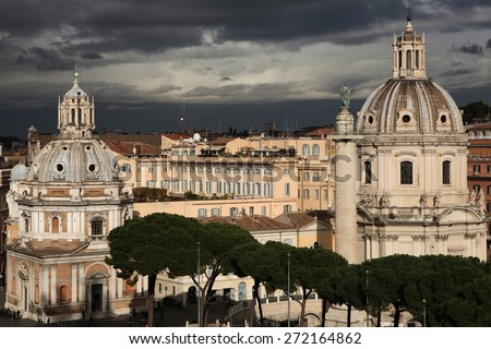 ROME, ITALY - DECEMBER 18, 2011: Trajan Column and Baroque churches of Santa Maria di Loreto (L) and Santissimo Nome di Maria al Foro Traiano (R) in Rome, Italy. - stock photo