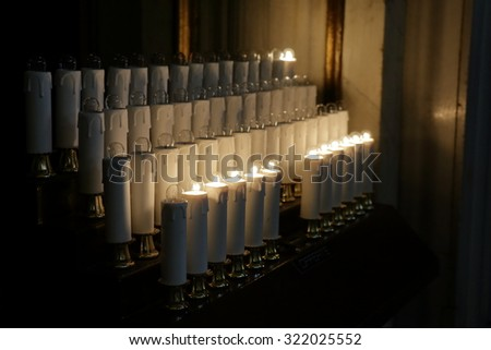 Rome, Italy. Electrical candles with incandescent lamps in basilica