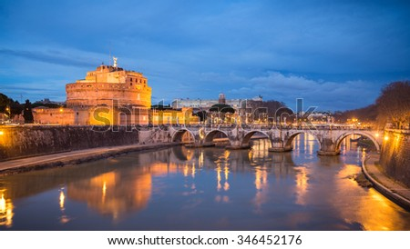 Rome, Italy - February 25, 2015: Castel Sant'Angelo in Rome after sunset, River Tiber and Bridge Ponte Vittorio Emanuele II