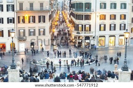 ROME, ITALY - FEBRUARY 25, 2015: Piazza de Spagna with many tourists in Rome city, Italy. Long exposure photo