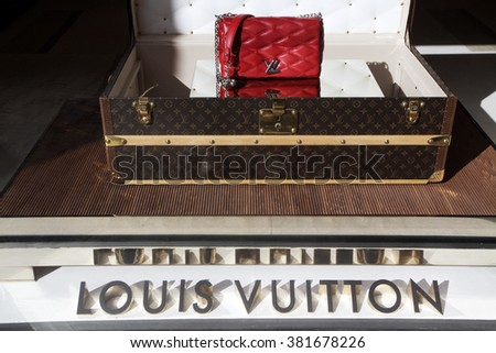 ROME, ITALY - FEBRUARY 21 2016: The window of Louis Vuitton store at Piazza S. Lorenzo in Lucina in Rome, Italy  - stock photo