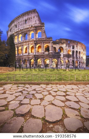 Rome, Italy: front view of Coliseum at dusk - stock photo