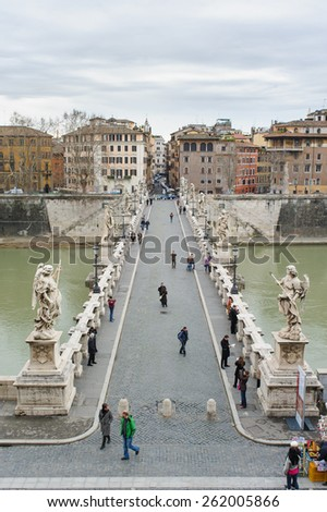 ROME, ITALY - JANUARY 27, 2010: Aelian Bridge(Ponte Sant'Angelo or Pons Aelius in Italian) is a Roman bridge over the tiber in Rome, Italy. There are statues of Angel on the bridge. - stock photo
