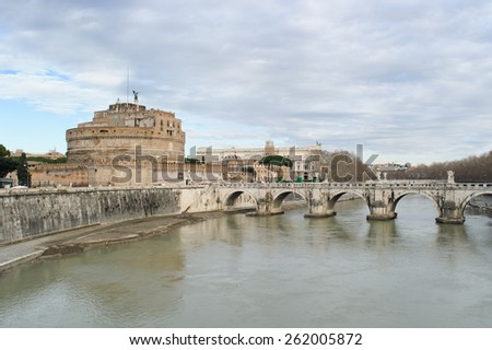 ROME, ITALY - JANUARY 27, 2010: Castel Sant'Angelo(the origin name is Mausoleum of Hadrian) is a towering cylindrical building situated on the bank of  the tiber river in Parco Adriano, Rome, Italy.  - stock photo