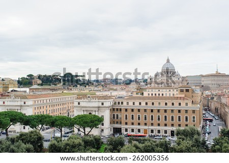 ROME, ITALY - JANUARY 27, 2010: View of Rome with the tiber river and dome of the St. Peter's Basilica from the top of Castel Sant'Angelo in Italy. - stock photo