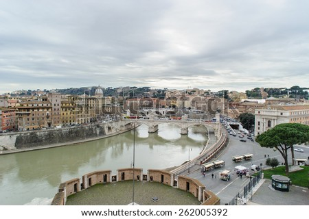 ROME, ITALY - JANUARY 27, 2010: View of Rome with the tiber river from the top of Castel Sant'Angelo in Italy. - stock photo