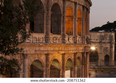 ROME, ITALY - 31 JULY 2014: Colosseum in the evening in Rome, Italy. The Colosseum is a major tourist attraction in Rome. Tourists visiting the Colosseum siting on the pavement. - stock photo