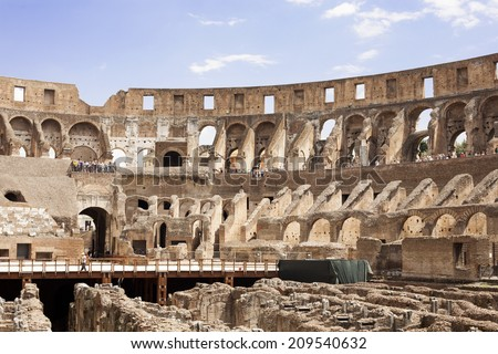 ROME, ITALY - 28 JULY 2014: Inside of the Colosseum, one of the most famous tourist attraction in Rome. - stock photo