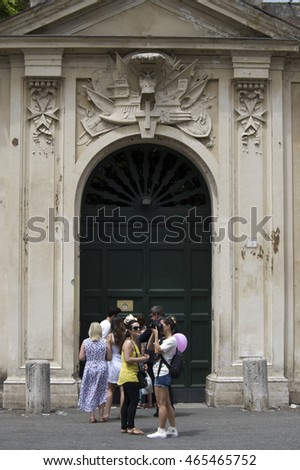 ROME, ITALY - JULY 23, 2016: line of tourists waiting to look through the keyhole of the Villa Magistrale dei Cavalieri di Malta