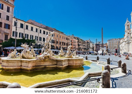 ROME; ITALY - JULY 15; 2014: Tourists visit the Piazza Navona. Piazza Navona is one of the most beautiful places in Rome.  - stock photo