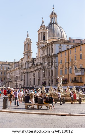 ROME, ITALY - JUNE 7, 2014 : A lot of tourists visit the Piazza Navona in summer. It is located in Rome, Italy. - stock photo
