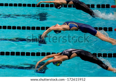 "ROME, ITALY - JUNE 13: Female swimmers dive into water at the start of a backstroke race during the International Swimming Championship ""Settecolli"" in Rome June 13, 2006."