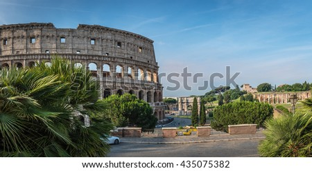 ROME, ITALY - JUNE 11, 2016: Panoramic view to the most visited monument of the world, the Colosseum, on the right the Arch of Constantine built in early IV century AD