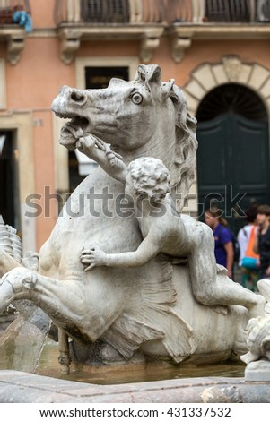 ROME, ITALY - JUNE 12, 2015:  Piazza Navona Fountain of Neptun. Designed by Giacomo della Porta (1574) and Antonio della Bitta. Rome, Italy
