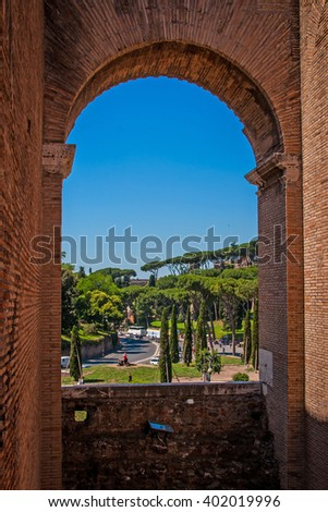 ROME, ITALY - JUNE, 6: View through an arch of the Colosseum on the square Colosseum on 6 june 2012 - stock photo