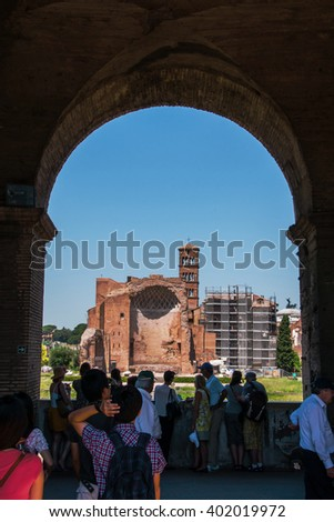 ROME, ITALY - JUNE, 6: View through an arch of the Colosseum on the temple of Venus on 6 june 2012 - stock photo